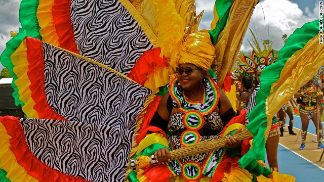 Participating in a Grand Kadooment band means you've chosen a group to parade with and purchased a team costume. Individual costumes tend to be larger and more greatly adorned.