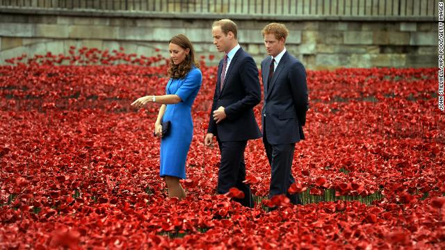 Catherine, Duchess of Cambridge; Prince William, Duke of Cambridge; and Prince Harry visit the Tower of London's ceramic poppy installation on Tuesday, August 5. The installation was part of the commemoration of the 100th anniversary of outbreak of World War I.