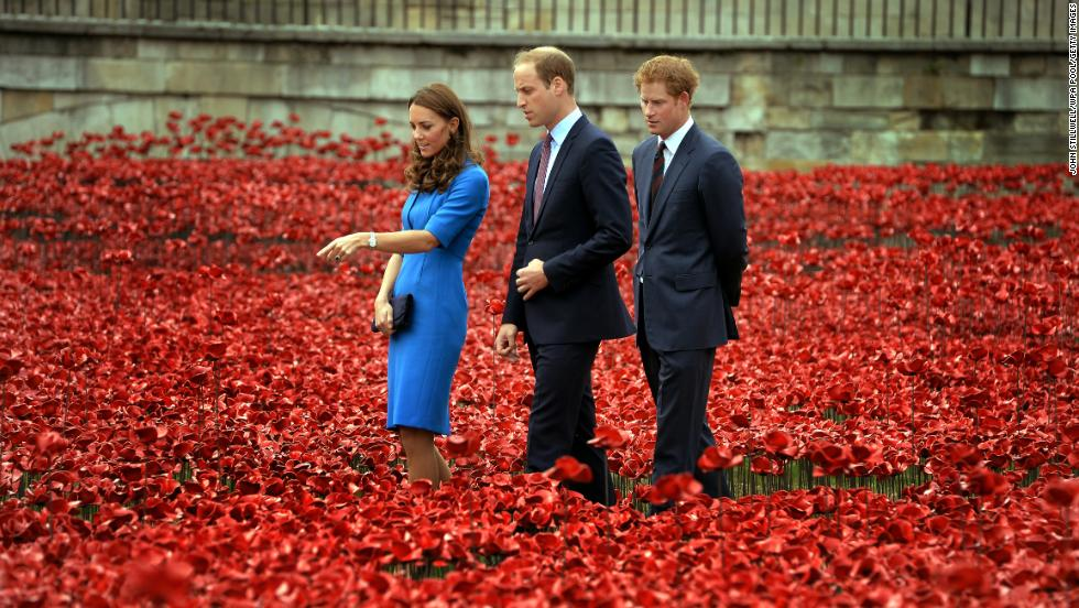 From right, Britain's Prince Harry, Prince William and Catherine, Duchess of Cambridge, visit the Tower of London's ceramic poppy installation Tuesday, August 5. Thousands of ceramic poppy flowers have been installed in the dry moat surrounding the tower to mark the 100th anniversary of World War I. There will be 888,246 ceramic poppies installed, one for each British military member that died during the war.