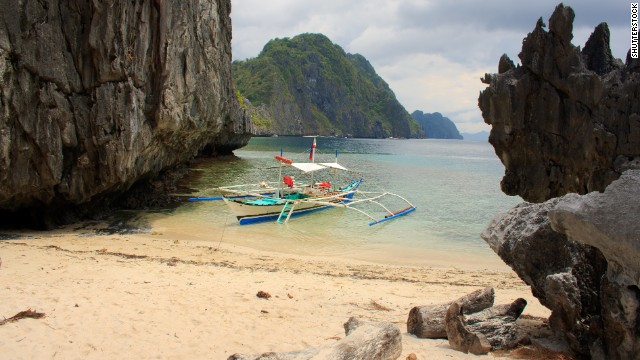 In the Philippine province of Palawan, limestone karst cliffs define the tucked-in beaches and lagoons of El Nido.