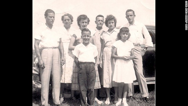 The Cash family in 1949, from left to right: Roy, Carrie (mother), Louise, Tommy (front left), Ray (father), Reba, Joanne (front right) and Johnny.