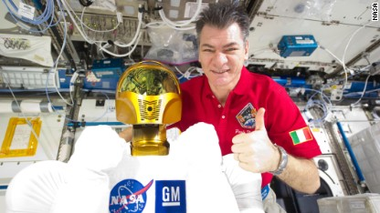 European Space Agency astronaut Paolo Nespoli, Expedition 26/27 flight engineer, poses with Robonaut 2, the dexterous humanoid astronaut helper, in the Destiny laboratory of the International Space Station.