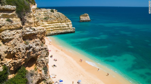 Near Lagoa on southern Portugal's Algarve coast, Praia da Marinha features imposing rock formations and calm waters. There's parking above and a staircase down to the beach. <!-- --> </br>