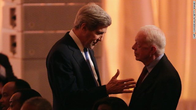 Secretary of State John Kerry, left, talks with former President Jimmy Carter.