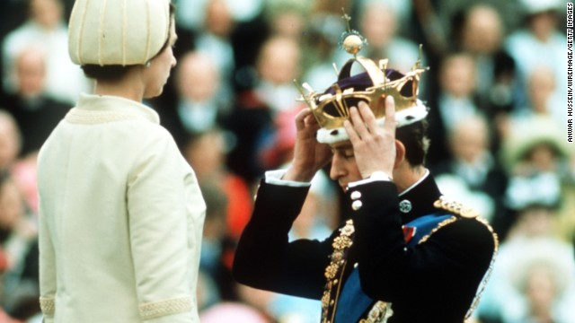 Prince Charles adjusts his coronet during his investiture ceremony as Prince of Wales in 1969.