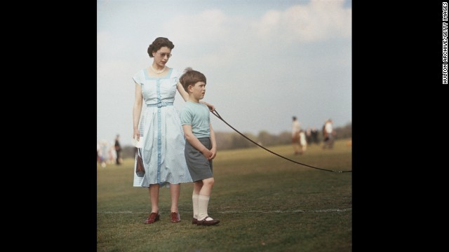 Queen Elizabeth II with her son Prince Charles during a polo match at Windsor Great Park in 1956.