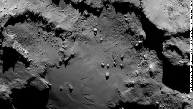 "The spacecraft sent this image as it approached the comet on August 6. From a distance of 130 kilometers (nearly 81 miles), it reveals detail of the smooth region on the comet's ""body"" section."