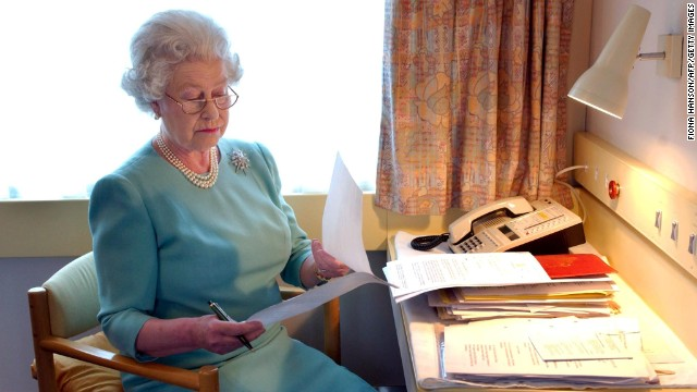 Queen Elizabeth II works aboard the royal train near Darlington, England, in May 2002.
