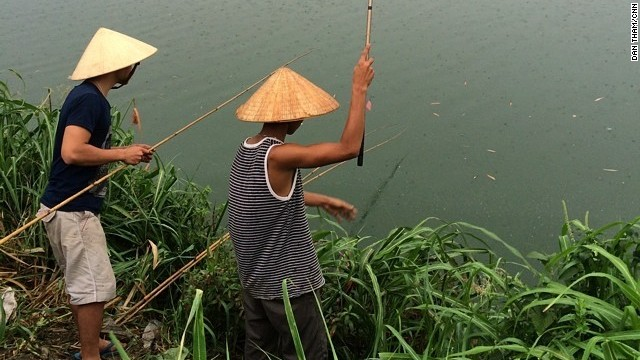"The Perfume River in Hue, Vietnam, is special to CNN's Dan Tham because his mother and grandparents were born there. He visited Vietnam in June and was ""naturally drawn to the river, its beauty and colors,"" he said. ""I would watch the boats drift down the river that <a href='http://ireport.cnn.com/docs/DOC-1159064'>Huetians</a> seem to treat with great reverence."""