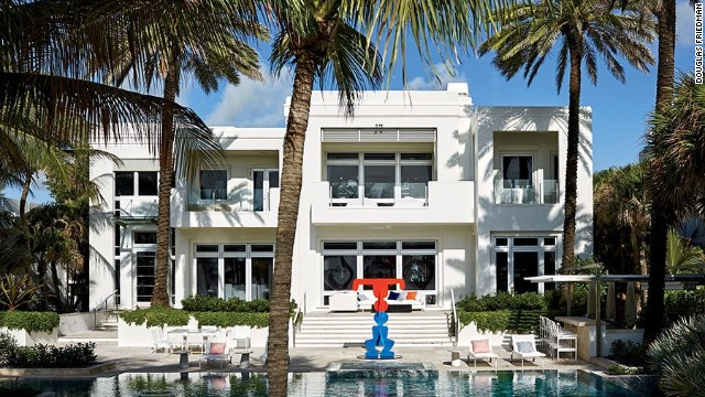 The rear façade of the house. See more images at <a href='http://www.architecturaldigest.com/celebrity-homes/2014/dee-and-tommy-hilfiger-florida-beach-house-slideshow?mbid=synd_cnn' target='_blank'>ArchitecturalDigest.com</a>