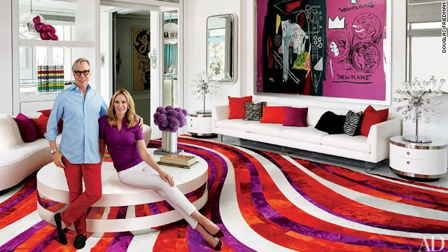 Fashion designer Tommy Hilfiger and his wife, Dee, relax in the living room of their Miami-area home, which was decorated by Martyn Lawrence Bullard. A collaborative painting by Andy Warhol and Jean-Michel Basquiat sets the chromatic tone for the room, where Vladimir Kagan sofas from Ralph Pucci International join a vintage cocktail table from JF Chen, Willy Rizzo side tables, and a Kyle Bunting rug designed by Bullard. See more images at <a href='http://www.architecturaldigest.com/celebrity-homes/2014/dee-and-tommy-hilfiger-florida-beach-house-slideshow?mbid=synd_cnn' target='_blank'>ArchitecturalDigest.com</a>