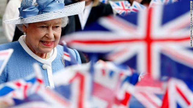 Flags are waved as Queen Elizabeth II leaves St. Paul's Cathedral following its 300th anniversary service in June 2011.