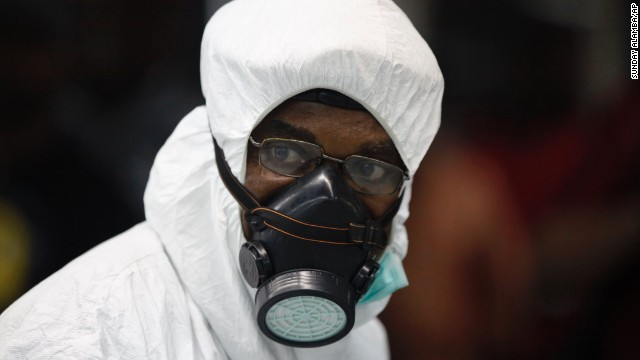 A Nigerian health official wears protective gear August 6 at Murtala Muhammed International Airport in Lagos.