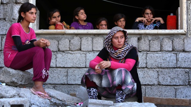 Yazidi women who fled violence in Sinjar, Iraq, take shelter at a school in Dohuk on August 5.