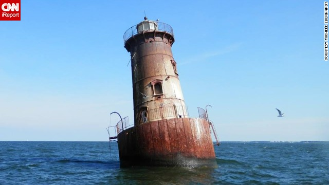 Sharps Island Light, located in Maryland's Chesapeake Bay, is only accessible by boat. In 1976, large ice floes <a href='http://tilghmanisland.com/lighthouse-tours/' target='_blank'>tilted the tower 15 degrees</a>.<strong> Click the double arrows to see more photos.</strong><!-- --> </br>