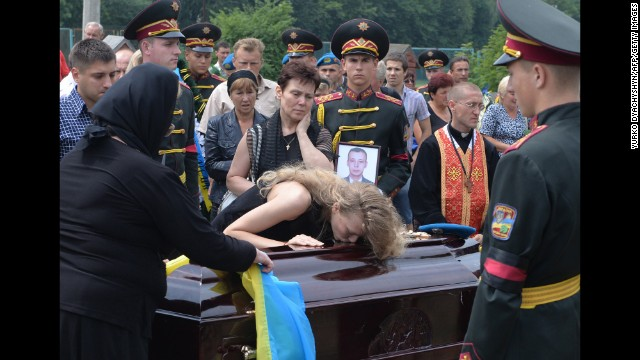 Relatives of Ukrainian military member Kyril Andrienko, who died in combat in eastern Ukraine, gather during his funeral in Lviv, Ukraine, on August 7.