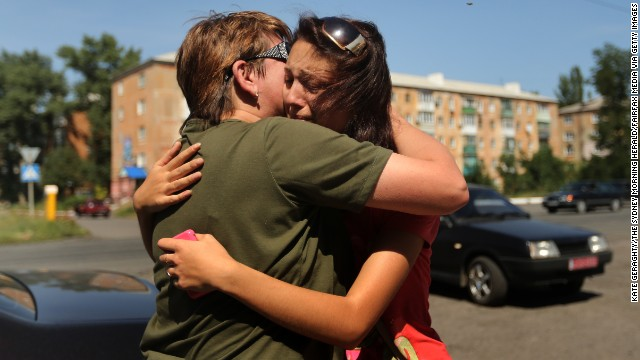 A woman says goodbye to her mother as she flees her home in Shakhtersk, Ukraine, on Tuesday, July 29. <a href='http://www.cnn.com/2014/05/27/world/gallery/ukraine-after-election/index.html'>See more photos of the crisis from earlier this year</a>