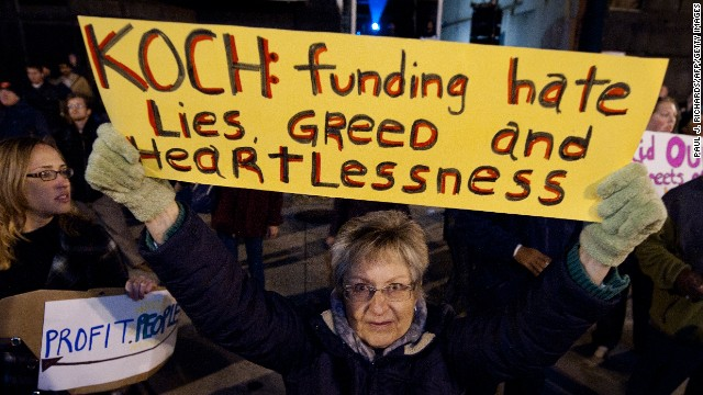 A woman protests against billionaire conservative donors Koch brothers in Washington in 2011.