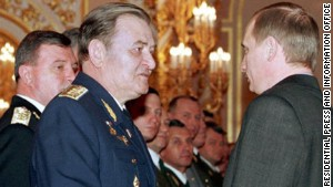 Vladimir Putin presents an award to Air Force Gen. Anatoly Kornukov in February, 2000.