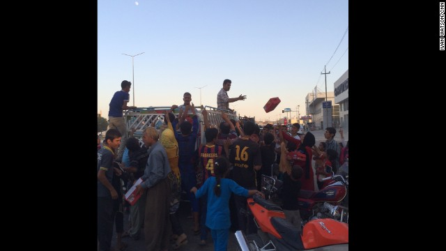 "ERBIL, IRAQ: ""Kurds in Erbil distributed some food and water to some of the more than 10,000 Iraqis who fled ISIS militants to this city today."" - CNN's Ivan Watson, August 7. Follow Ivan (<a href='http://instagram.com/ivancnn' target='_blank'>@ivancnn</a>) and other CNNers along on Instagram at <a href='http://instagram.com/cnn' target='_blank'>instagram.com/cnn</a>."