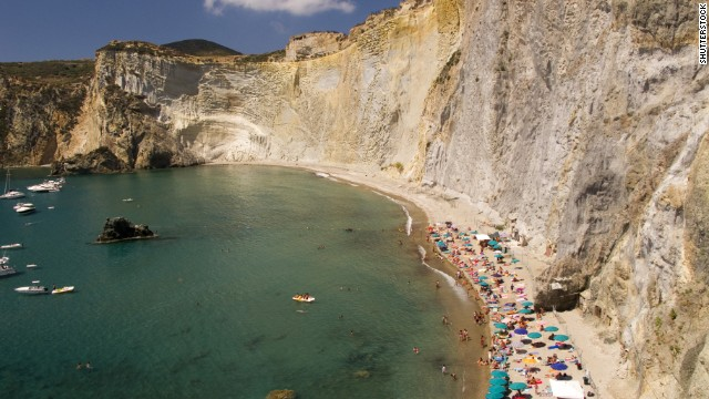 A steep rock wall surrounds Chiaia di Luna on the island of Ponza, the most visited of Italy's Pontine Islands.