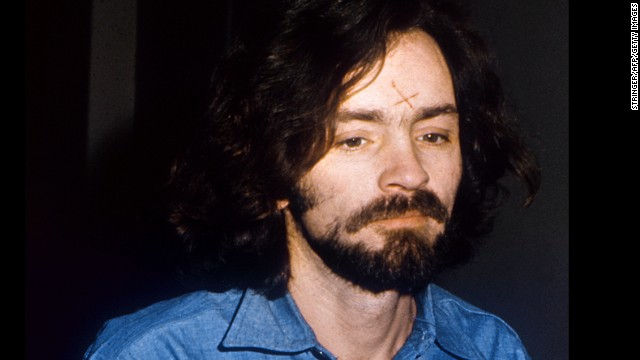 "Manson appears with an ""X"" cut into his forehead when the trial starts on June 16, 1970. It was said to symbolize being crossed out of society. He later altered the scar to become a swastika."