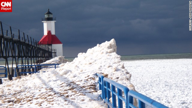 "<a href='http://ireport.cnn.com/docs/DOC-1157394'>Jenn Landreth</a> travels up to Lake Michigan once a year for the ice carving festivals and had to get a photo of this lighthouse in St. Joseph, Michigan. She loves the contrast here of the lighthouse in the snow. ""It's funny, people tell me how beautiful these lighthouses are in the summer, and I have yet to make it up there when there isn't snow."""