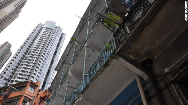 The Blue House, which has architecturally significant balconies, is just a few blocks from fancy new highrises that have sprung up in Hong Kong over the last two decades.