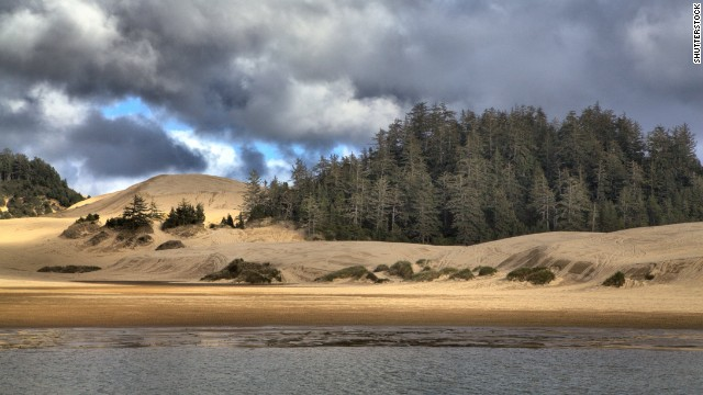 Stretching 40 miles along the coast from Florence to Coos Bay, Oregon Dunes National Recreation Area is home to sand dunes that tower up to 500 feet above sea level.