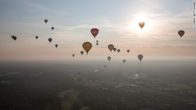 AUGUST 8 - BRISTOL, ENGLAND: Hot air balloons depart from Aston Court on the first full day of the Bristol International Balloon Fiesta. Now in its 36th year, the four-day fiesta is Europe's largest annual hot air balloon event and <a href='http://www.bristolballoonfiesta.co.uk/content/8/about-us.aspx' target='_blank'>attracts more than 100 hot air balloons and 500,000 visitors.</a>