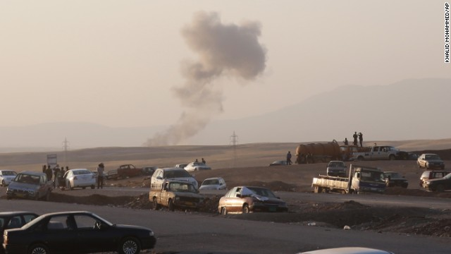 Smoke rises after airstrikes targeted ISIS militants outside Irbil on Friday, August 8.