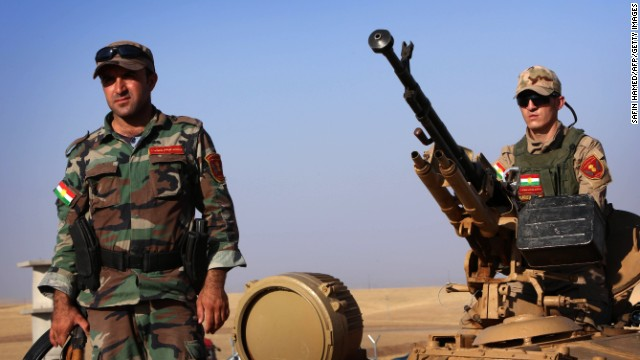 Kurdish Peshmerga fighters take position on the front line on August 8.