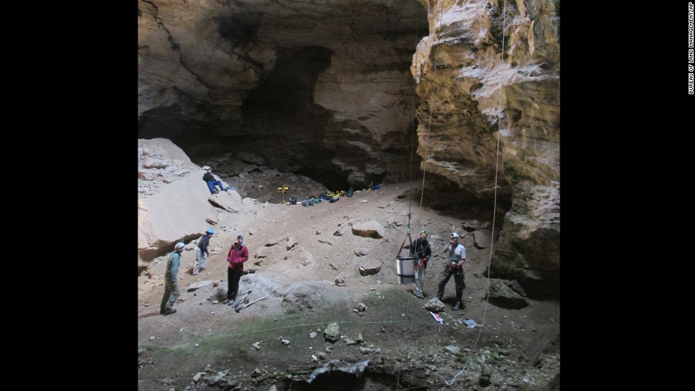 Images taken in July from the Bureau of Land Management show researchers inside the Natural Trap Cave in north-central Wyoming, which contains the remains of tens of thousands of animals.