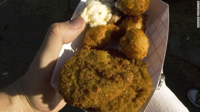 Fried green tomatoes and corn fritters were served hot and fresh with a scoop of honey butter.