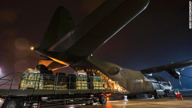 Humanitarian aid for Iraq is loaded onto an aircraft in Norton, England, on Friday, August 8.