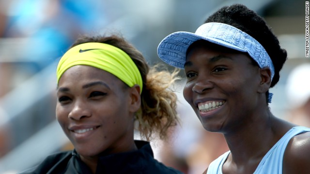 Serena and Venus Williams pose before their women's semifinals match in the Rogers Cup at Uniprix Stadium.