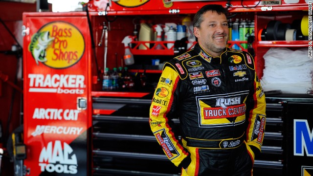 Driver Tony Stewart looks on in the garage area during practice for the NASCAR Sprint Cup Series Cheez-It 355 at Watkins Glen International on Friday, August 8, in Watkins Glen, New York. Stewart is a three-time champion in NASCAR's top division and also won a sprint car championship in 1995.