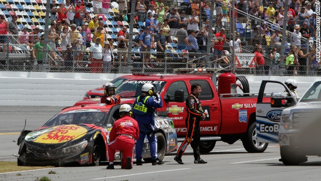 Stewart gets out of his car after an incident during the NASCAR Sprint Cup Series Coke Zero 400 at Daytona International Speedway on July 6 in Daytona Beach, Florida.