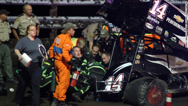 Personnel prepare to load Stewart into an ambulance after he was involved in a four-car wreck at Southern Iowa Speedway in Oskaloosa, Iowa. Stewart underwent successful surgery Tuesday, August 6, 2013, to repair the broken right tibia and fibula suffered in the wreck.