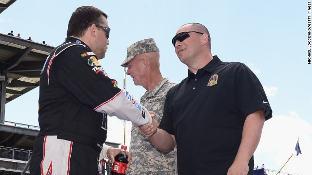 "Stewart shakes hands with Gunnery Sgt. Samuel Deeds at the Indianapolis Motor Speedway on July 28. As winner of the annual Crown Royal ""Your Hero's Name Here"" program, Deeds received naming rights to the July 28 NASCAR Sprint Cup Series race at the Brickyard."