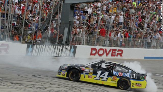Stewart celebrates with a burnout after winning the NASCAR Sprint Cup Series FedEx 400 at Dover International Speedway on June 2, 2013, in Dover, Delaware.