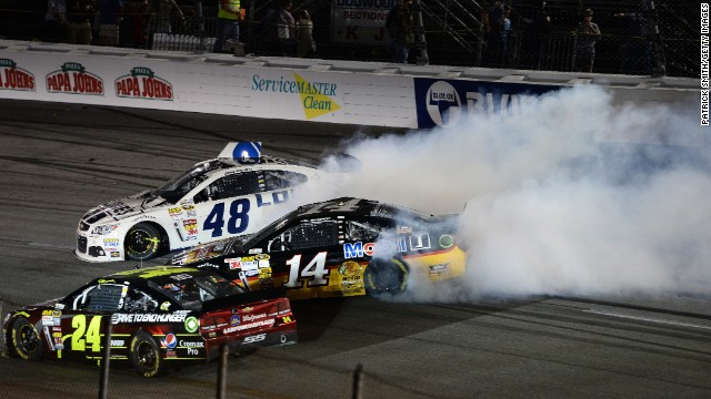 Stewart, in car 14, spins out along with Jimmie Johnson, in car 48, after an on-track incident during the NASCAR Sprint Cup Series Toyota Owners 400 at Richmond International Raceway on April 27, 2013, in Richmond, Virginia.