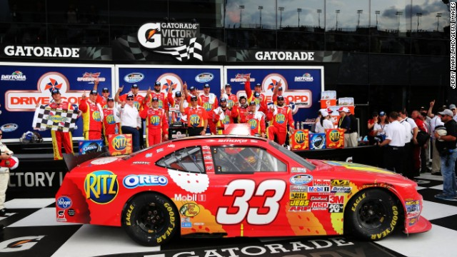 Stewart poses in the victory lane after winning the NASCAR Nationwide Series DRIVE4COPD 300 at Daytona International Speedway on February 23, 2013, in Daytona Beach, Florida.