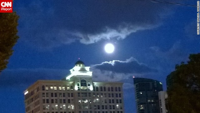 "<a href='http://ireport.cnn.com/docs/DOC-1160084'>Malkiel Barroso</a> said the supermoon caught his attention as it lit up this building in Fort Lauderdale, Florida, on Saturday. ""It was very radiant; it made all the unclouded space look blue and brought out the darkness in the clouds."""