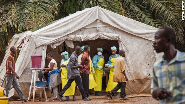 Health workers in Kenema, Sierra Leone, screen people for the Ebola virus on Saturday, August 9, before they enter the Kenema Government Hospital.