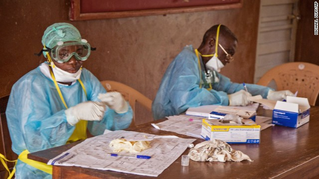 Health care workers wear protective gear at the Kenema Government Hospital on August 9.