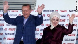 Turkish president elect Recep Tayyip Erdogan and his wife Emnine cheer their supporters after the results of the elections at the headquarter of Turkey's Ruling Party Justce and Developmant Party (AKP) in Ankara, Turkey, on Sunday, August 10. Erdogan will become the country's first directly-elected president by a wide margin of votes, according the semi-official Anadolu News Agency.