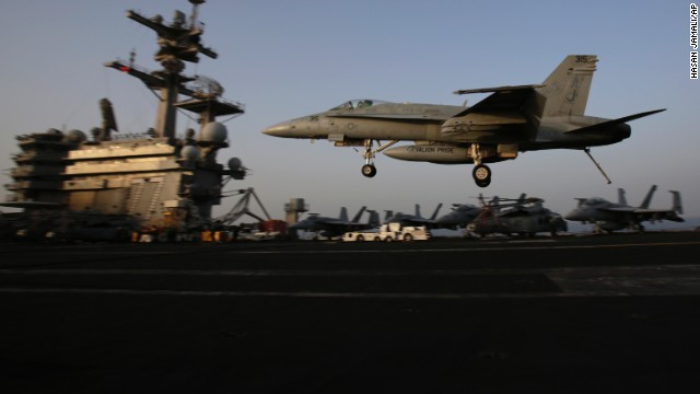 An F/A-18C Hornet lands on the flight deck of the USS George H.W. Bush on August 10.