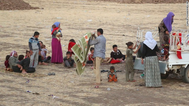 Displaced Iraqis from the Yazidi community settle outside the Bajid Kandala camp on Saturday, August 9.
