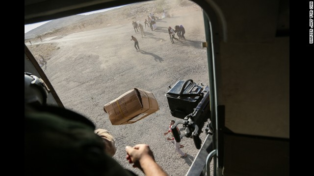 A CNN crew was on the flight, which took diapers, milk, water and food to the site. Thousands of people have been fleeing from the militant group ISIS, which has taken over large swaths of northern and western Iraq as it seeks to create an Islamic caliphate that stretches from Syria into Iraq.